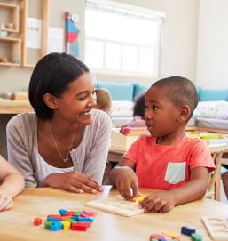 teacher and little boy talking
